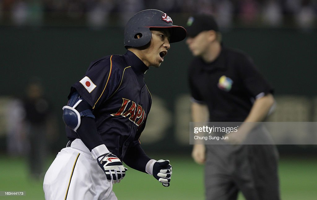 Infielder Takashi Toritani # 1 of Japan reacts after a home run top of the first inning during the World Baseball Classic Second Round Pool 1 game between Japan and the Netherlands at Tokyo Dome on March 10, 2013 in Tokyo, Japan.