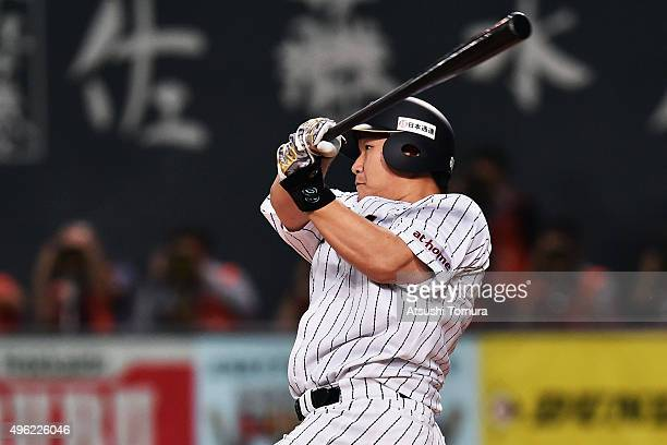 Infielder Takeya Nakamura of Japan hits a single in the bottom of third inning during the WBSC Premier 12 match between Japan and South Korea at the...