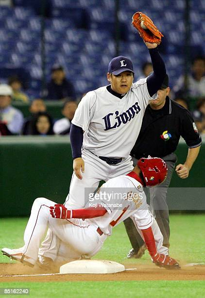 Infielder Takeya Nakamura of Saitama Seibu Lions tag out Outfielder Sun Lingfeng of China during a friendly match between China and Saitama Seibu...