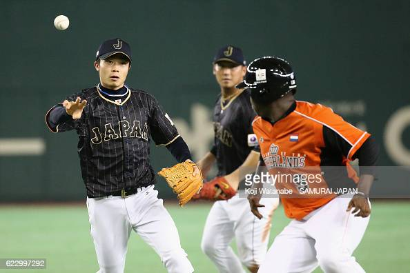 Infielder Takuya Nakashima of Japan chase Infielder Juremi Profar of the Netherlands in a rundown in the third inning during the international...