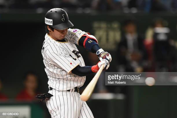 Infielder Tetsuto Yamada hits during the World Baseball Classic Pool B Game Six between China and Japan at Tokyo Dome on March 10 2017 in Tokyo Japan