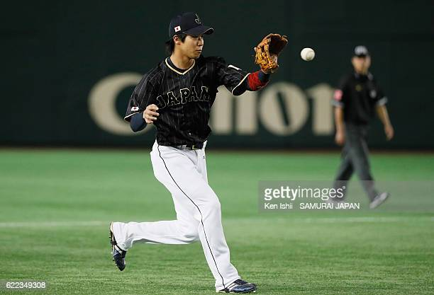 Infielder Tetsuto Yamada of Japan fields in the sixth inning during the international friendly match between Mexico and Japan at the Tokyo Dome on...
