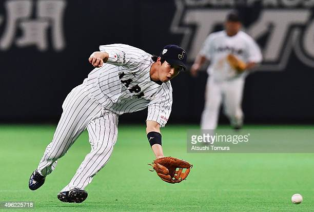 Infielder Tetsuto Yamada of Japan fields in the top of the third inning during the WBSC Premier 12 match between Japan and South Korea at the Sapporo...