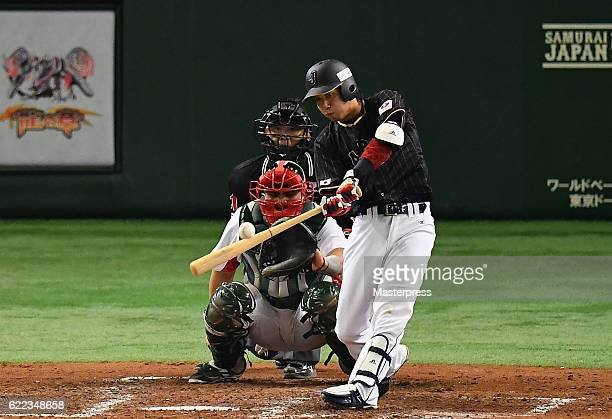 Infielder Tetsuto Yamada of Japan flies out in the fifth inning during the international friendly match between Mexico and Japan at the Tokyo Dome on...