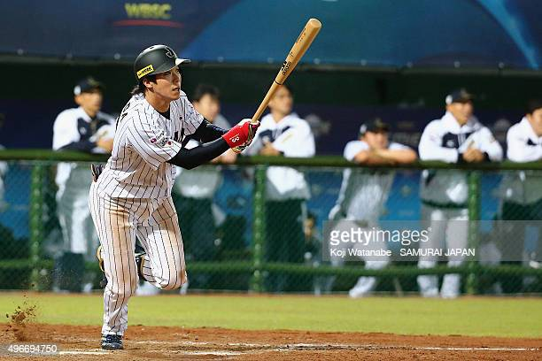 Infielder Tetsuto Yamada of Japan hits a double in the bottom of the ninth inning during the WBSC Premier 12 match between Mexico and Japan at the...