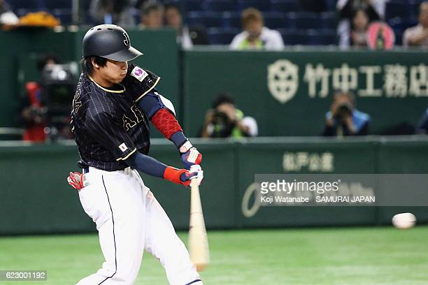Infielder Tetsuto Yamada of Japan hits a RBI single in the seventh inning during the international friendly match between Netherlands and Japan at...