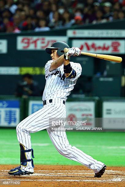Infielder Tetsuto Yamada of Samurai Japan hits a dable in the bottom half of the eigthth inning bats during the friendly match between Samurai Japan...