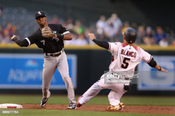 Infielder Tim Anderson of the Chicago White Sox throws over the sliding Gregor Blanco of the Arizona Diamondbacks to complete a double play during...