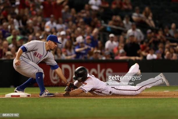 Infielder TJ Rivera of the New York Mets tags out Jeff Mathis of the Arizona Diamondbacks as he slides into third base during the seventh inning of...