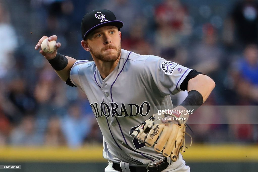 Infielder Trevor Story #27 of the Colorado Rockies fields a ground ball during the MLB game against the Arizona Diamondbacks at Chase Field on April 30, 2017 in Phoenix, Arizona.