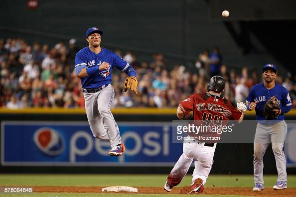 Infielder Troy Tulowitzki of the Toronto Blue Jays throws over Paul Goldschmidt of the Arizona Diamondbacks to complete a double play during the...