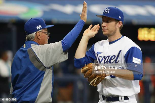 Infielder Ty Kelly of Israel high fives with Manager Jerry Weinstein after the World Baseball Classic Pool A Game Five between Netherlands and Israel...