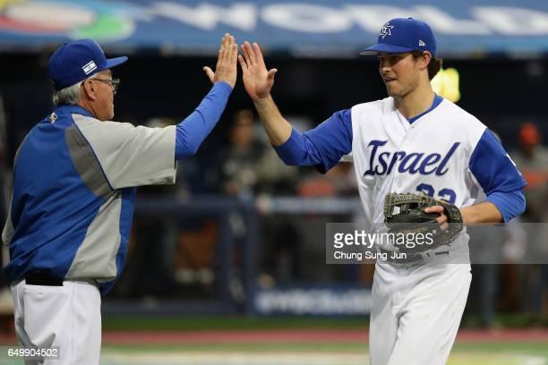Infielder Tyler Krieger of Israel high fives with Manager Jerry Weinstein after the World Baseball Classic Pool A Game Five between Netherlands and...