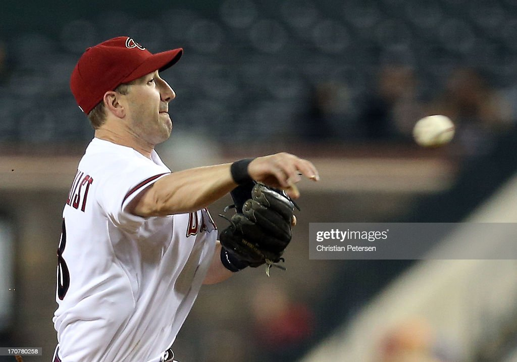 Infielder <a gi-track='captionPersonalityLinkClicked' href=/galleries/search?phrase=Willie+Bloomquist&family=editorial&specificpeople=214000 ng-click='$event.stopPropagation()'>Willie Bloomquist</a> #18 of the Arizona Diamondbacks fields a ground ball out against the Miami Marlins during the MLB game at Chase Field on June 17, 2013 in Phoenix, Arizona.