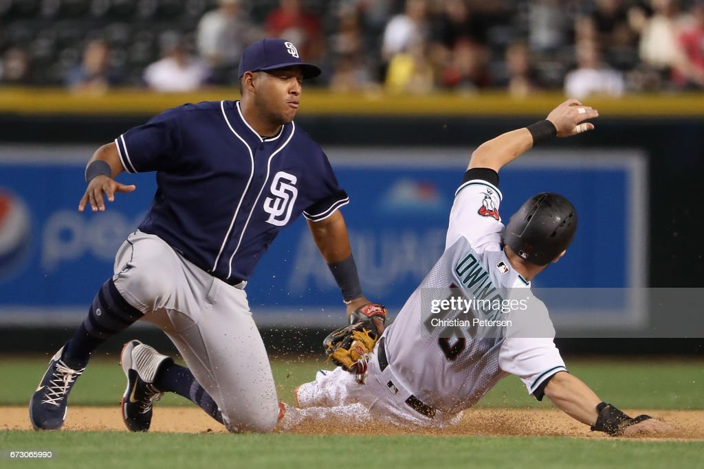 Infielder Yangervis Solarte #26 of the San Diego Padres tags out Chris Owings #16 of the Arizona Diamondbacks as he attempts to steal second base during the fourth inning of the MLB game at Chase Field on April 25, 2017 in Phoenix, Arizona.