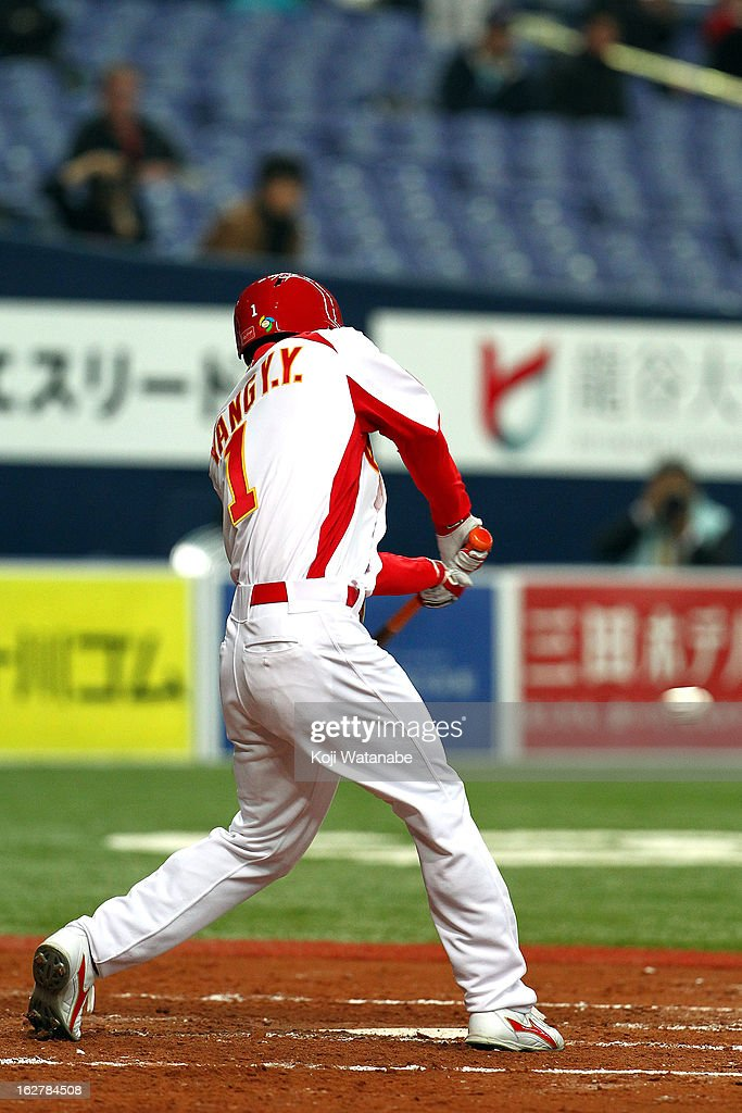 Infielder Yanyong Yang #1 of China one-run hits a fly in the top half of the second inning during the friendly game between Orix Buffaloes and China at Kyocera Dome Osaka on February 27, 2013 in Osaka, Japan.