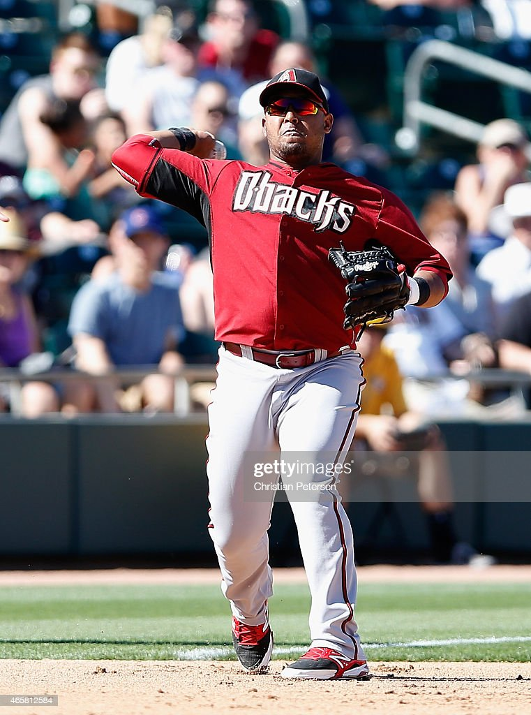 Infielder Yasmany Tomas #24 of the Arizona Diamondbacks fields a ground ball out against the Oakland Athletics during the spring training game at HoHoKam Stadium on March 10, 2015 in Mesa, Arizona.
