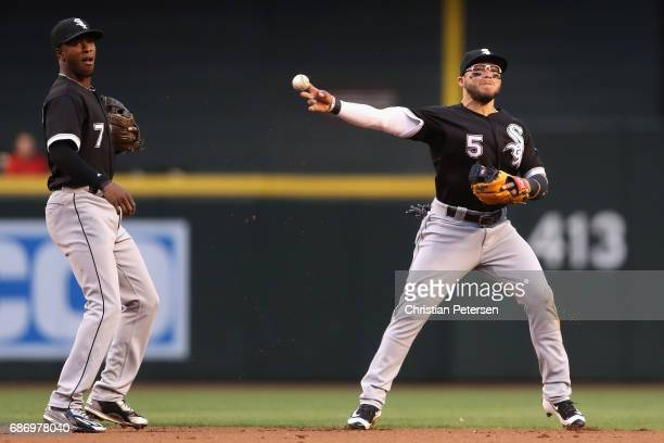 Infielder Yolmer Sanchez of the Chicago White Sox fields a infield single hit by Gregor Blanco of the Arizona Diamondbacks during the first inning of...