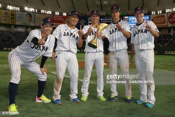 Infielder Yota Kyoda Catcher Kensuke Kondo Infielder Ryoma Nishikawa Outfielder Seiji Uebayashi and Infielder Go Matsumoto of Japan pose with the...