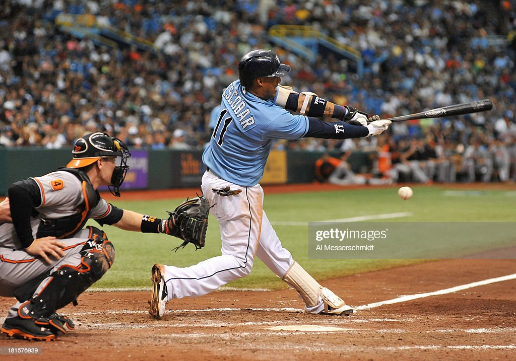 Infielder <a gi-track='captionPersonalityLinkClicked' href=/galleries/search?phrase=Yunel+Escobar&family=editorial&specificpeople=757358 ng-click='$event.stopPropagation()'>Yunel Escobar</a> #11 of the Tampa Bay Rays bats against the Baltimore Orioles September 22, 2013 at Tropicana Field in St. Petersburg, Florida. The Rays won 3 - 1.