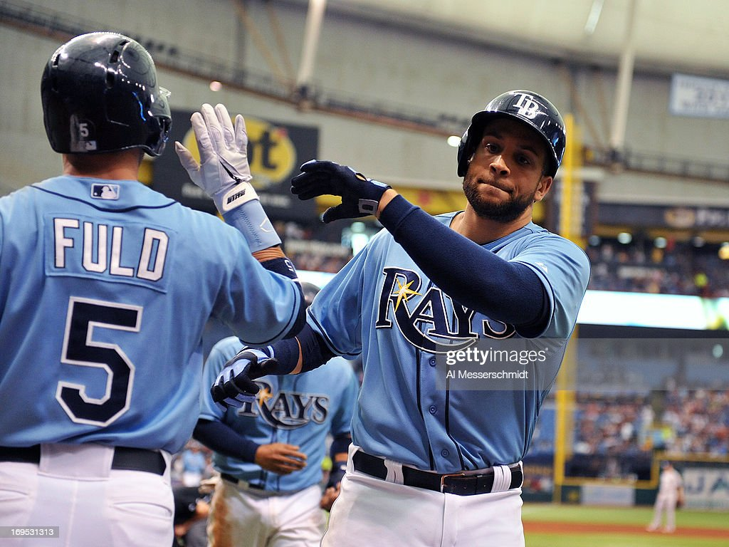 Infielder <a gi-track='captionPersonalityLinkClicked' href=/galleries/search?phrase=Yunel+Escobar&family=editorial&specificpeople=757358 ng-click='$event.stopPropagation()'>Yunel Escobar</a> #11 of the Tampa Bay Rays celebrates after scoring a run in the sixth inning against the New York Yankees May 26, 2013 at Tropicana Field in St. Petersburg, Florida.