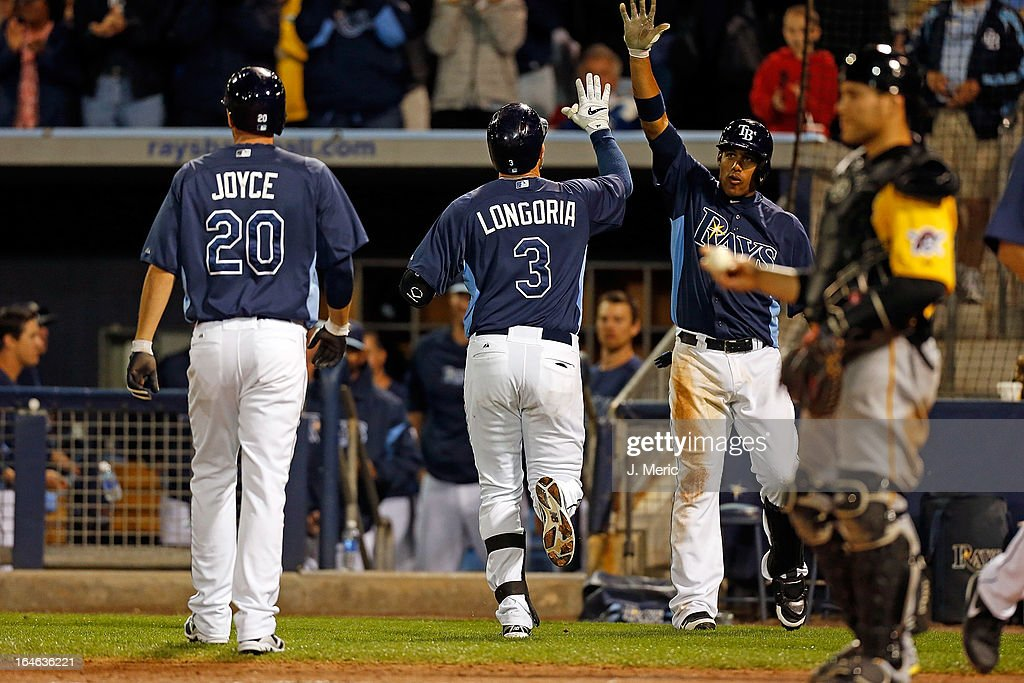 Infielder <a gi-track='captionPersonalityLinkClicked' href=/galleries/search?phrase=Yunel+Escobar&family=editorial&specificpeople=757358 ng-click='$event.stopPropagation()'>Yunel Escobar</a> #11 of the Tampa Bay Rays congratulates <a gi-track='captionPersonalityLinkClicked' href=/galleries/search?phrase=Evan+Longoria&family=editorial&specificpeople=2349329 ng-click='$event.stopPropagation()'>Evan Longoria</a> #3 after his two run home run against the Pittsburgh Pirates during a Grapefruit League Spring Training Game at the Charlotte Sports Complex on March 25, 2013 in Port Charlotte, Florida.