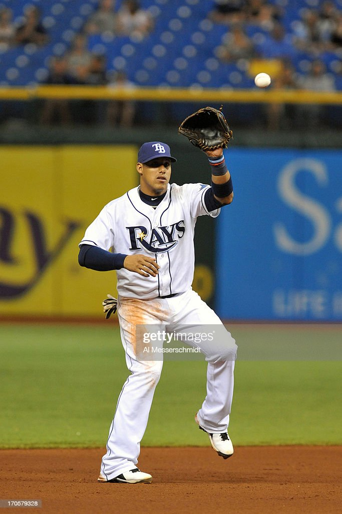 Infielder <a gi-track='captionPersonalityLinkClicked' href=/galleries/search?phrase=Yunel+Escobar&family=editorial&specificpeople=757358 ng-click='$event.stopPropagation()'>Yunel Escobar</a> #11 of the Tampa Bay Rays gets set for a catch against the Kansas City Royals June 14, 2013 at Tropicana Field in St. Petersburg, Florida.