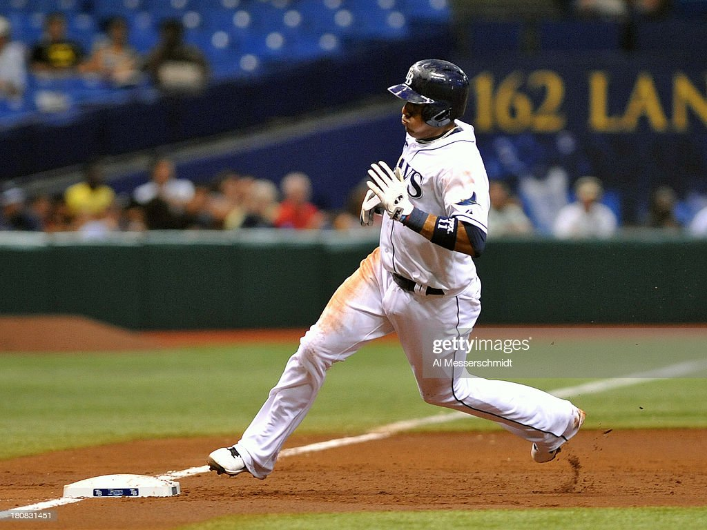 Infielder <a gi-track='captionPersonalityLinkClicked' href=/galleries/search?phrase=Yunel+Escobar&family=editorial&specificpeople=757358 ng-click='$event.stopPropagation()'>Yunel Escobar</a> #11 of the Tampa Bay Rays rounds 3rd base against the Texas Rangers September 16, 2013 at Tropicana Field in St. Petersburg, Florida.
