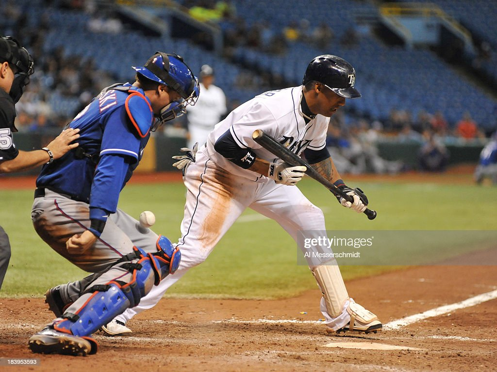 Infielder <a gi-track='captionPersonalityLinkClicked' href=/galleries/search?phrase=Yunel+Escobar&family=editorial&specificpeople=757358 ng-click='$event.stopPropagation()'>Yunel Escobar</a> #11 of the Tampa Bay Rays sets to bunt against the Texas Rangers September 18, 2013 at Tropicana Field in St. Petersburg, Florida.