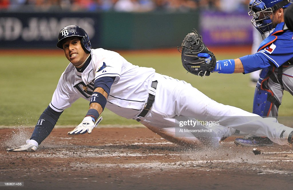 Infielder <a gi-track='captionPersonalityLinkClicked' href=/galleries/search?phrase=Yunel+Escobar&family=editorial&specificpeople=757358 ng-click='$event.stopPropagation()'>Yunel Escobar</a> #11 of the Tampa Bay Rays slides into home plate against the Texas Rangers September 16, 2013 at Tropicana Field in St. Petersburg, Florida. Escobar was tagged out. The Rays won 6 - 2.