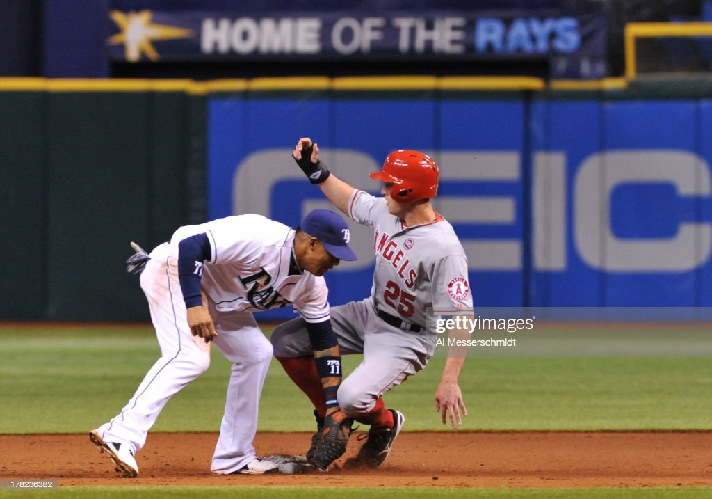 Infielder Yunel Escobar #11 of the Tampa Bay Rays tags outfielder Peter Bourjos #25 of the Los Angeles Angels at 2nd base August 27, 2013 at Tropicana Field in St. Petersburg, Florida.