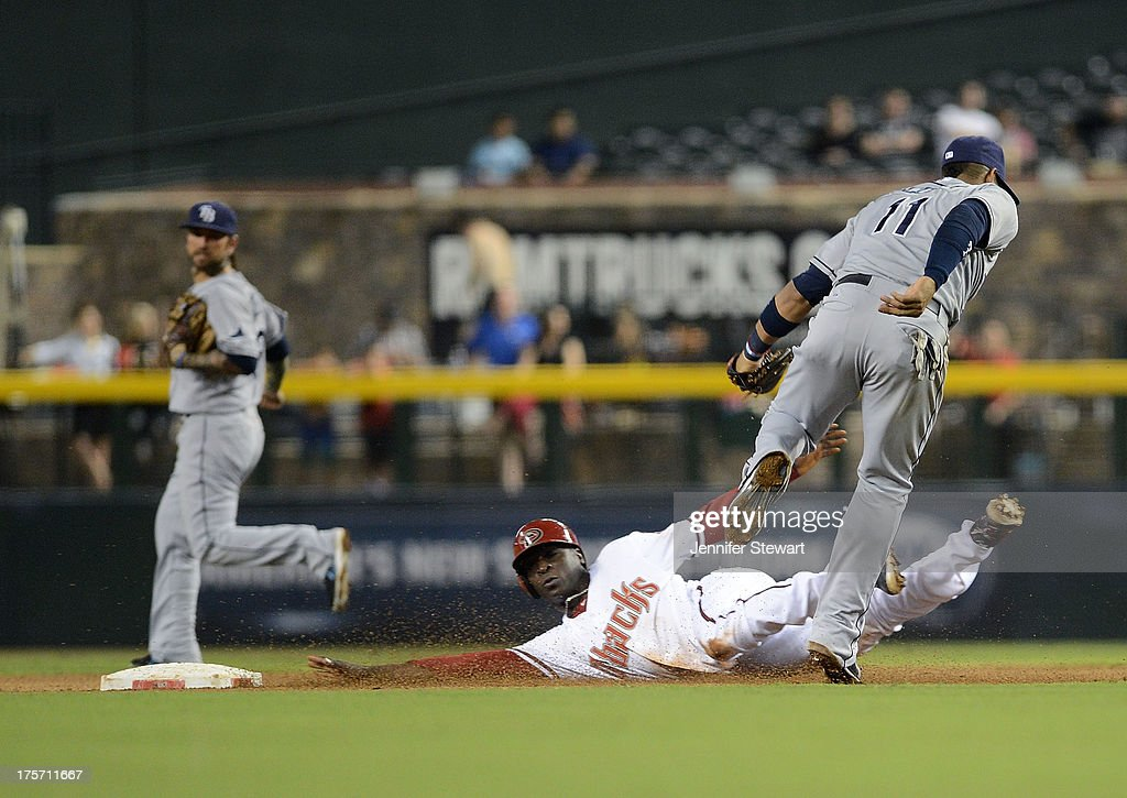Infielder Yunel Escobar #11 of the Tampa Bay Rays tags the sliding Didi Gregorius #1 of the Arizona Diamondbacks as he attempts to steal second base in the fourth inning at Chase Field on August 6, 2013 in Phoenix, Arizona.