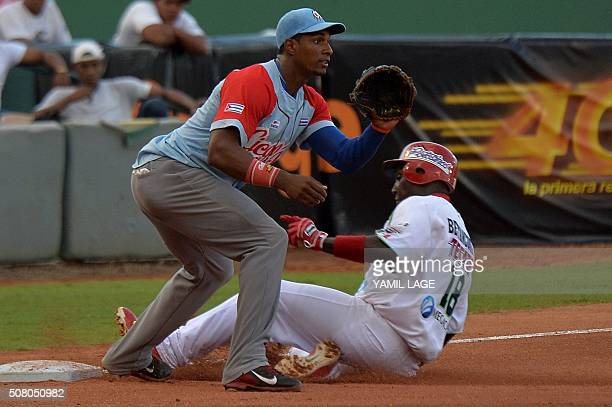 Infielder Yurisbel Gracial of Cuba makes an out on third base against Yunieski Betancourt of Mexico during their 2016 Caribbean baseball series game...