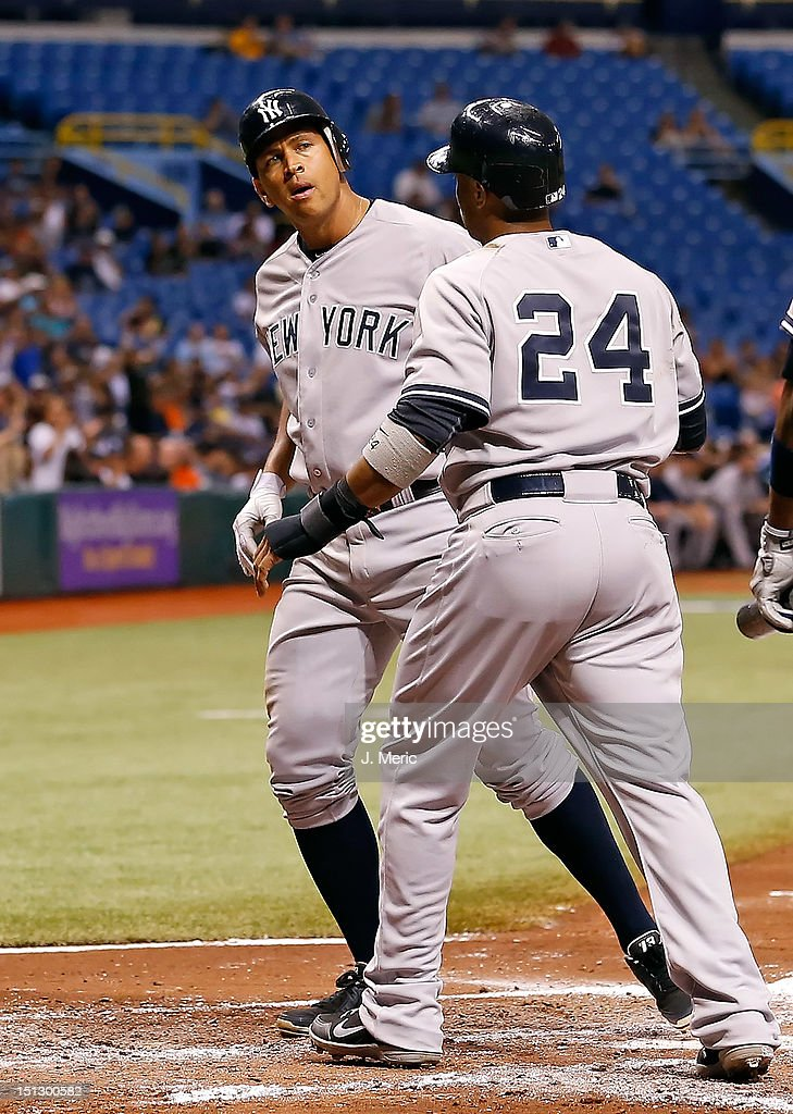 Infielders Alex Rodriguez #13 (L) and <a gi-track='captionPersonalityLinkClicked' href=/galleries/search?phrase=Robinson+Cano&family=editorial&specificpeople=538362 ng-click='$event.stopPropagation()'>Robinson Cano</a> #24 of the New York Yankees score against the Tampa Bay Rays during the game at Tropicana Field on September 5, 2012 in St. Petersburg, Florida.