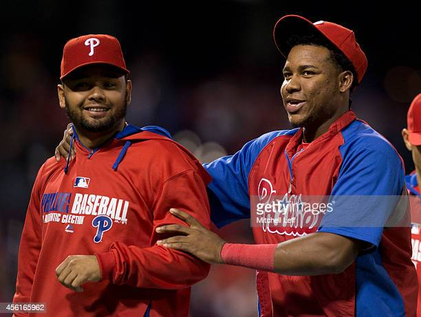 Infielders Andres Blanco and Maikel Franco of the Philadelphia Phillies react after defeating the Atlanta Braves on September 26 2014 at Citizens...