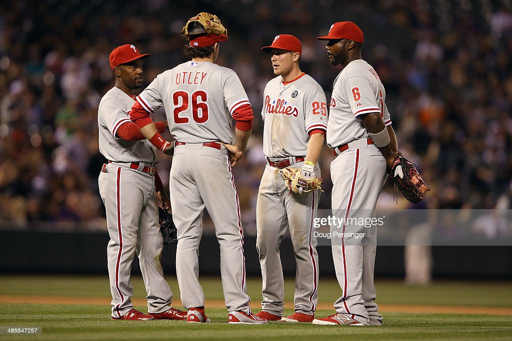 Infielders <a gi-track='captionPersonalityLinkClicked' href=/galleries/search?phrase=Jimmy+Rollins&family=editorial&specificpeople=204478 ng-click='$event.stopPropagation()'>Jimmy Rollins</a> #11, <a gi-track='captionPersonalityLinkClicked' href=/galleries/search?phrase=Chase+Utley&family=editorial&specificpeople=161391 ng-click='$event.stopPropagation()'>Chase Utley</a> #26, <a gi-track='captionPersonalityLinkClicked' href=/galleries/search?phrase=Cody+Asche&family=editorial&specificpeople=10524550 ng-click='$event.stopPropagation()'>Cody Asche</a> #25 and <a gi-track='captionPersonalityLinkClicked' href=/galleries/search?phrase=Ryan+Howard&family=editorial&specificpeople=551402 ng-click='$event.stopPropagation()'>Ryan Howard</a> #6 of the Philadelphia Phillies of the Philadelphia Phillies await a pitching change in the seventh inning at Coors Field on April 18, 2014 in Denver, Colorado.