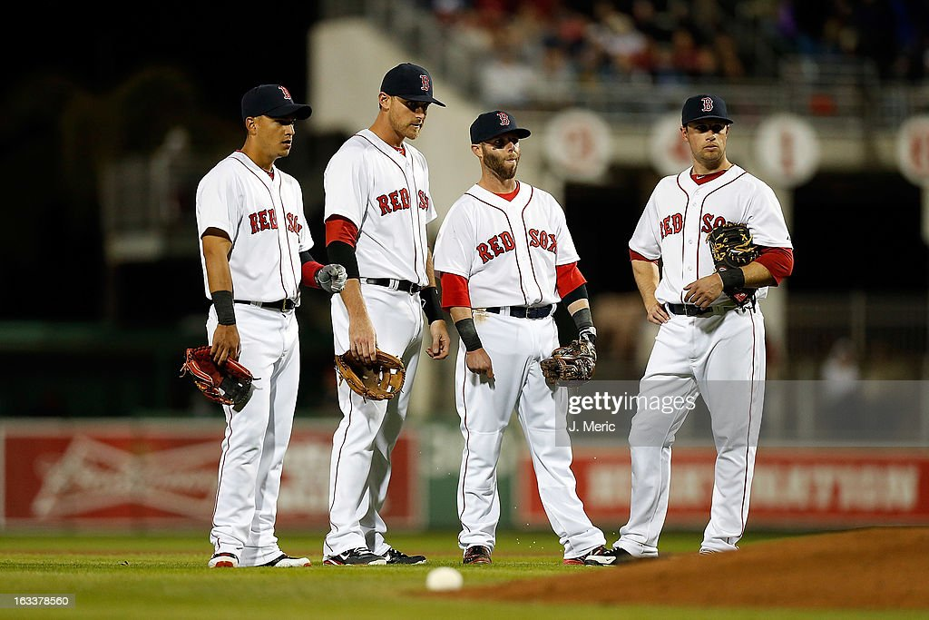 Infielders Jose Inglesias #10 (l to r), Will Middlebrooks #16, <a gi-track='captionPersonalityLinkClicked' href=/galleries/search?phrase=Dustin+Pedroia&family=editorial&specificpeople=836339 ng-click='$event.stopPropagation()'>Dustin Pedroia</a> #15 and <a gi-track='captionPersonalityLinkClicked' href=/galleries/search?phrase=Daniel+Nava&family=editorial&specificpeople=670454 ng-click='$event.stopPropagation()'>Daniel Nava</a> #29 of the Boston Red Sox wait for a pitching change against the Minnesota Twins during a Grapefruit League Spring Training Game at JetBlue Park on March 8, 2013 in Fort Myers, Florida.