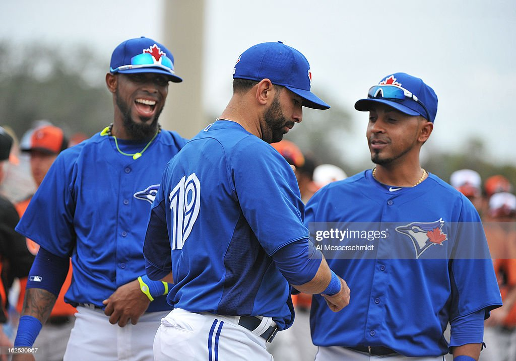 Infielders Jose Reyes #7 (left) and <a gi-track='captionPersonalityLinkClicked' href=/galleries/search?phrase=Maicer+Izturis&family=editorial&specificpeople=239100 ng-click='$event.stopPropagation()'>Maicer Izturis</a> #3 of the Toronto Blue Jays take the field with outfielder Jose Bautista #19 before play against the Baltimore Orioles February 24, 2013 at the Florida Auto Exchange Stadium in Dunedin, Florida.