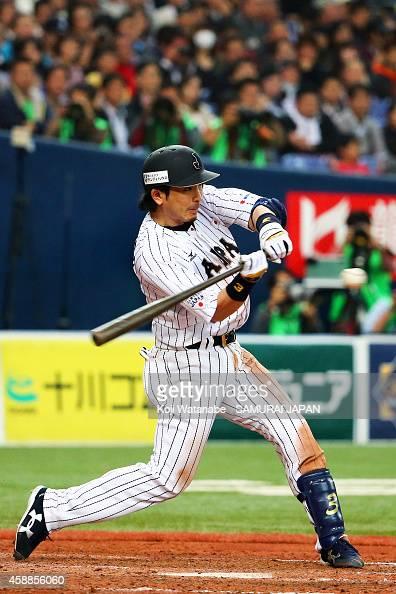 Infielders Nobuhiro Matsuda of Samurai Japan bats during in the bottom half of the fourthh inningthe game one of Samurai Japan and MLB All Stars at...