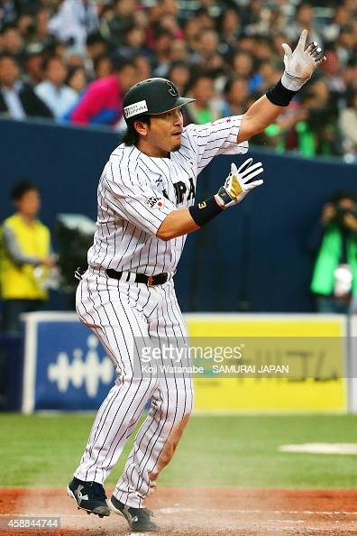 Infielders Nobuhiro Matsuda of Samurai Japan celerates after scoring in the bottom of the fourth inning during the game one of Samurai Japan and MLB...