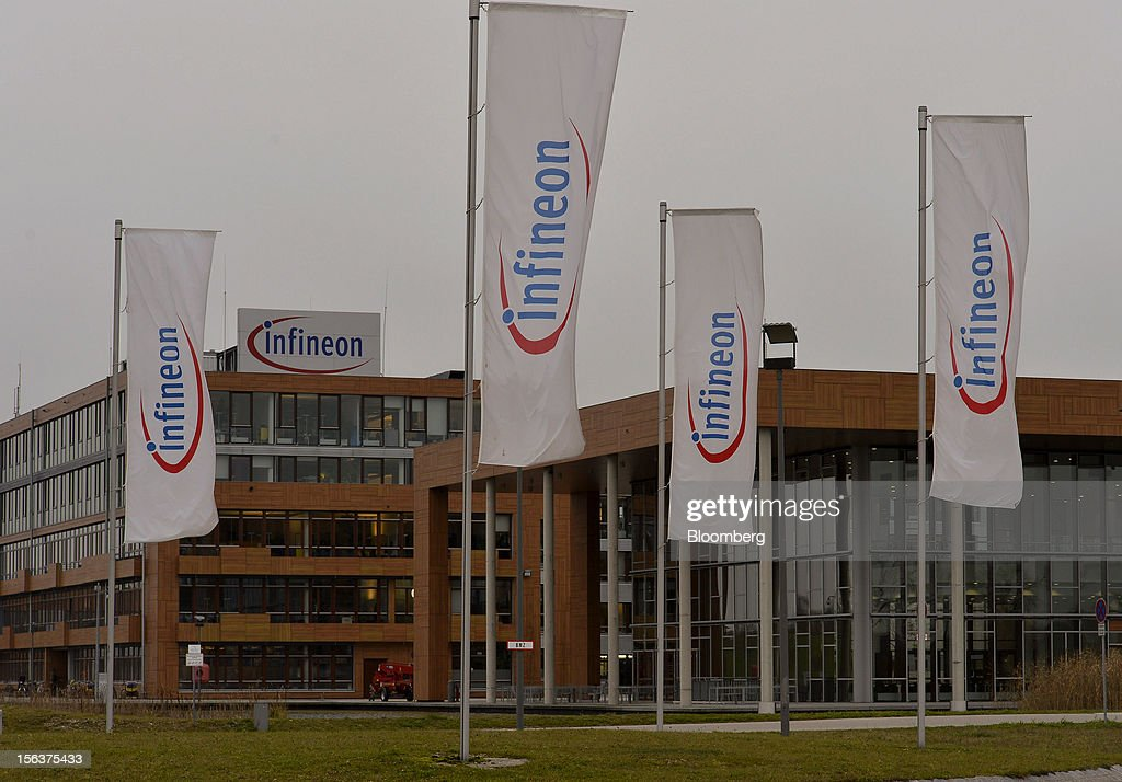 Infineon Technologies AG flags are seen flying outside the company's headquarters in Munich, Germany, on Wednesday, Nov. 14, 2012. Infineon Technologies AG, Europe's second-biggest semiconductor maker, reported fourth-quarter revenue that declined less than analysts expected and forecast sales to drop next year. Photographer: Guenter Schiffmann/Bloomberg via Getty Images