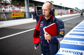 Infiniti Red Bull Racing Chief Technical Officer Adrian Newey walks up the pitlane ahead of the Italian Formula One Grand Prix at Autodromo Nazionale...