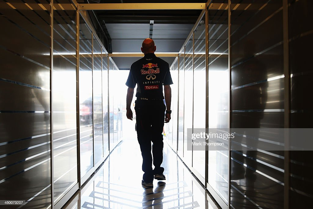 Infiniti Red Bull Racing Chief Technical Officer <a gi-track='captionPersonalityLinkClicked' href=/galleries/search?phrase=Adrian+Newey&family=editorial&specificpeople=215410 ng-click='$event.stopPropagation()'>Adrian Newey</a> walks out the back of his team garage following qualifying for the United States Formula One Grand Prix at Circuit of The Americas on November 16, 2013 in Austin, United States.