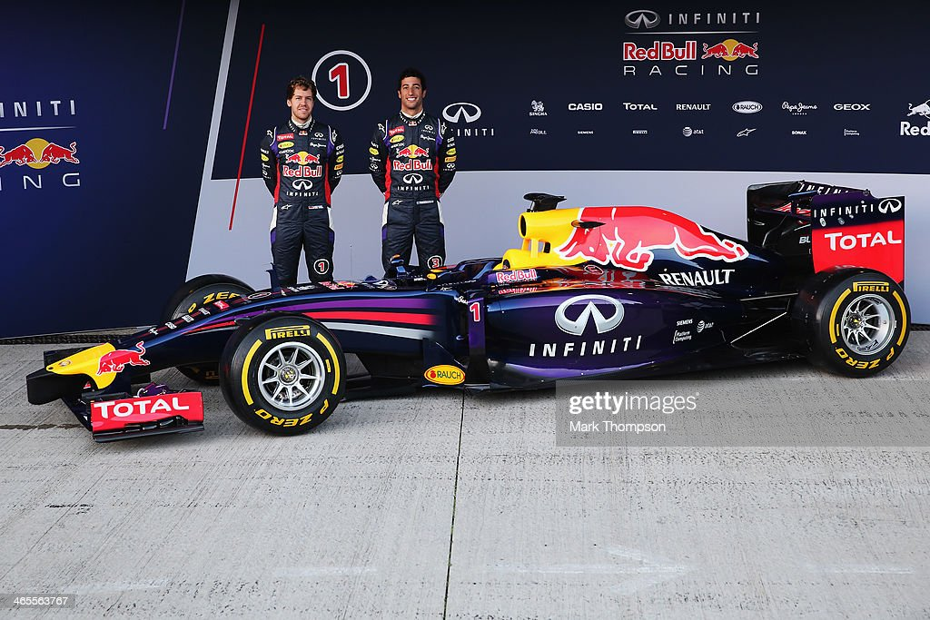 Infiniti Red Bull Racing drivers <a gi-track='captionPersonalityLinkClicked' href=/galleries/search?phrase=Sebastian+Vettel&family=editorial&specificpeople=2233605 ng-click='$event.stopPropagation()'>Sebastian Vettel</a> (L) of Germany and <a gi-track='captionPersonalityLinkClicked' href=/galleries/search?phrase=Daniel+Ricciardo&family=editorial&specificpeople=6547569 ng-click='$event.stopPropagation()'>Daniel Ricciardo</a> (R) of Australia attend the launch of their new RB10 Formula One car at the Circuito de Jerez on January 28, 2014 in Jerez de la Frontera, Spain.