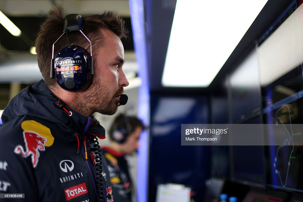 Infiniti Red Bull Racing Race Engineer Simon Rennie works in the garage during day two of testing at Silverstone Circuit on July 9, 2014 in Northampton, England.