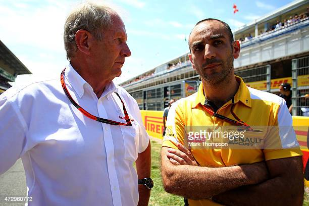 Infiniti Red Bull Racing team consultant Dr Helmut Marko speaks with Renault's Cyril Abiteboul during the Spanish Formula One Grand Prix at Circuit...