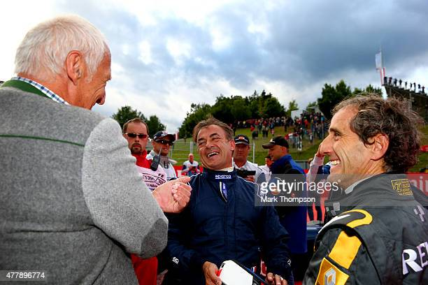 Infiniti Red Bull Racing team owner and CEO of the Austria energy drink producer Red Bull Dietrich Mateschitz speaks with Jean Alesi and Alain Prost...