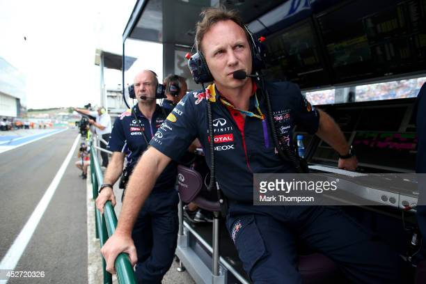 Infiniti Red Bull Racing Team Principal Christian Horner and Adrian Newey the Infiniti Red Bull Racing Chief Technical Officer look on from the pit...