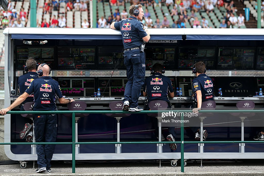 Infiniti Red Bull Racing Team Principal <a gi-track='captionPersonalityLinkClicked' href=/galleries/search?phrase=Christian+Horner&family=editorial&specificpeople=228706 ng-click='$event.stopPropagation()'>Christian Horner</a> and <a gi-track='captionPersonalityLinkClicked' href=/galleries/search?phrase=Adrian+Newey&family=editorial&specificpeople=215410 ng-click='$event.stopPropagation()'>Adrian Newey</a>, the Infiniti Red Bull Racing Chief Technical Officer look on from the pit wall during qualifying ahead of the Hungarian Formula One Grand Prix at Hungaroring on July 26, 2014 in Budapest, Hungary.
