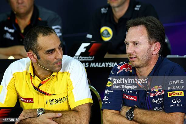 Infiniti Red Bull Racing Team Principal Christian Horner and Renault's Cyril Abiteboul attend a press conference following practice for the Malaysia...
